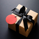 Gift Box with Red Price Tag and Tied Black Bow. - PhotoDune Item for Sale