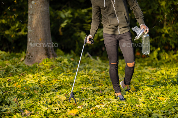 Low section of volunteer conserving environment from pollution and plastic - Stock Photo - Images