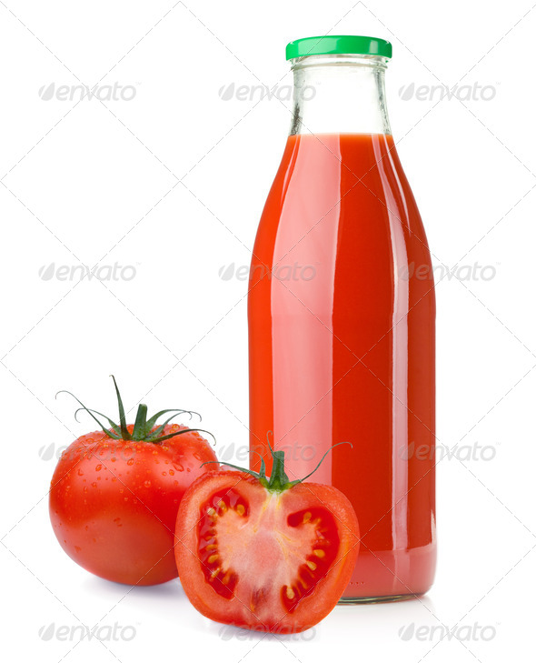 Bottle of tomato juice and ripe tomatoes - Stock Photo - Images
