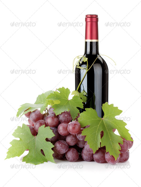 Red wine bottle and grapes - Stock Photo - Images