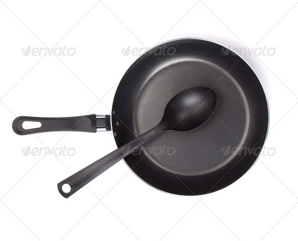 Frying pan with utensil - Stock Photo - Images