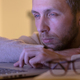 Sleepy tired man designer working on typing on laptop - PhotoDune Item for Sale