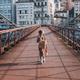 Cute kid walking the Saone River over the pedestrian Saint-Vincent Bridge alone - PhotoDune Item for Sale