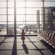 Young passenger in empty airport staying in terminal hall before her flight - PhotoDune Item for Sale