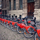 Row of electro bicycles for rent on a street of Lyon - PhotoDune Item for Sale