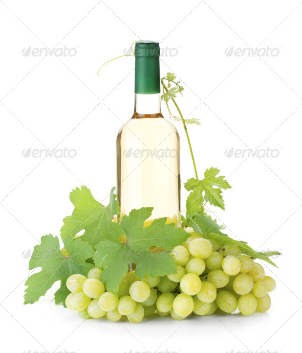 White wine bottle and grapes - Stock Photo - Images