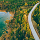 Aerial view of winding road and golden colored autumn or fall forest - PhotoDune Item for Sale