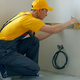 Builder using a spirit level to measure a wall. - PhotoDune Item for Sale