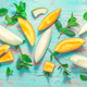 Healthy snack - Piel de sapo melon and cantaloupe with fresh mint on cyan wooden table - PhotoDune Item for Sale