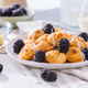 Dutch mini pancakes called poffertjes with blackberries and apple compot - PhotoDune Item for Sale