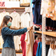 Young Asian woman wearing surgical mask shopping in clothes stores at the mall - PhotoDune Item for Sale