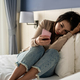 Lonely young woman holding smart phone and feeling depressed and stressed - PhotoDune Item for Sale