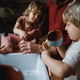 Unrecognizable father with two small children washing dishes indoors at home, daily chores concept - PhotoDune Item for Sale