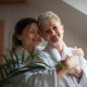Happy senior mother in bathrobe with adult daughter hugging indoors at home, selfcare concept - PhotoDune Item for Sale