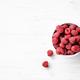 Raspberries in Bowl on White Background. - PhotoDune Item for Sale
