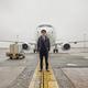 Portrait of happy confident caucasian airplane crew near plane - PhotoDune Item for Sale