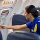 Happy professional stewardess is preparing salon before night fly - PhotoDune Item for Sale