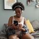 Serene woman in headphones choosing music in playlist - PhotoDune Item for Sale