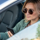 Young contemporary woman driving car and texting - PhotoDune Item for Sale
