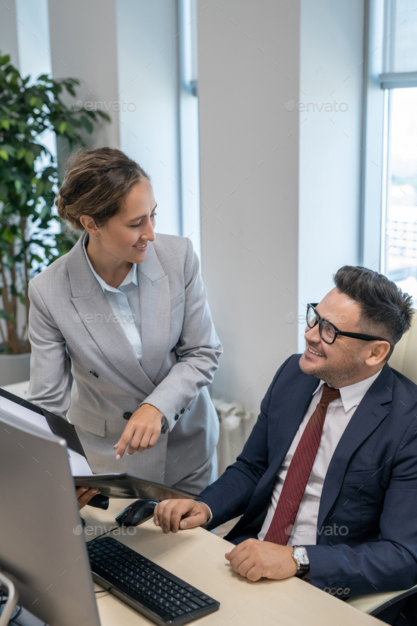 Elegant secretary consulting with her boss in office - Stock Photo - Images