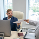 Young businessman taking financial papers given by his colleague - PhotoDune Item for Sale