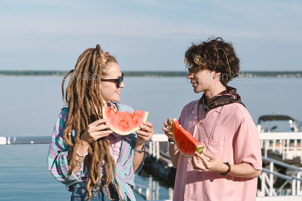 Happy young dates with slices of fresh juicy watermelon - Stock Photo - Images