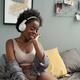 Young smiling woman enjoying music in headphones - PhotoDune Item for Sale