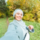 Fashionable young muslim asian girl in hijab taking a selfie on smartphone outdoors in autumn park - PhotoDune Item for Sale