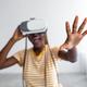 Excited black lady using VR glasses, grabbing something - PhotoDune Item for Sale