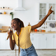 Young black woman having fun while cooking at kitchen - PhotoDune Item for Sale