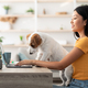 Funny puppy helping its mother to work from home - PhotoDune Item for Sale