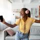 Joyful afro american long-haired woman singing and dancing, using smartphone - PhotoDune Item for Sale