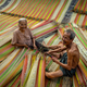 Top view of old Vietnamese lover craftsman making the traditional vietnam mats - PhotoDune Item for Sale