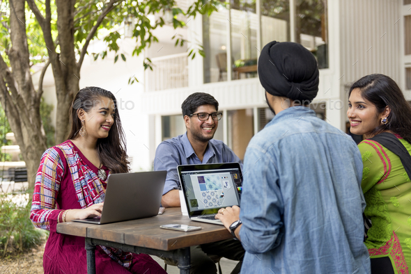 Group of Indian people are using computer laptop - Stock Photo - Images