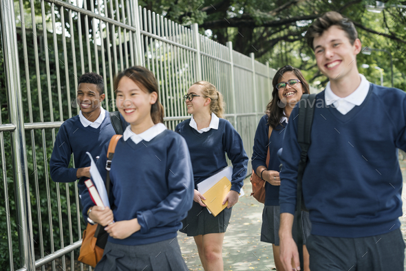 Students on their way home from school - Stock Photo - Images