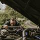 Man repairing a car engine outdoors - PhotoDune Item for Sale