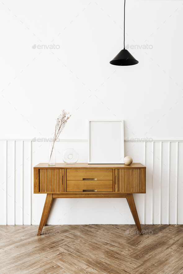 Picture frame on a wooden sideboard table - Stock Photo - Images