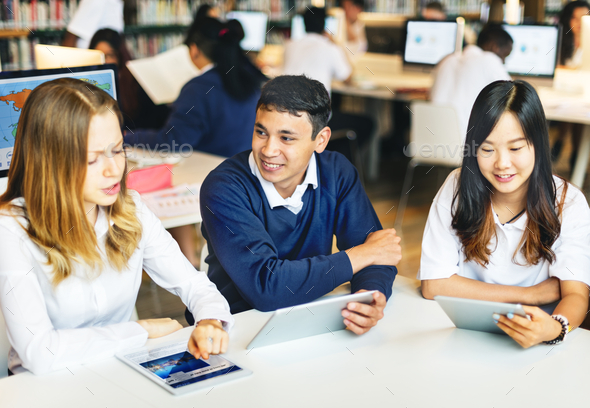 Students learning in group at the library - Stock Photo - Images