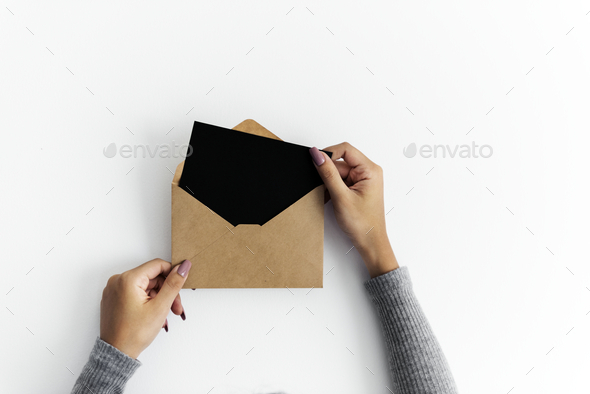 Woman hands holding envolope on white background - Stock Photo - Images