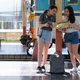 Two teenage girls plan a train trip to the platform for a trip. - PhotoDune Item for Sale