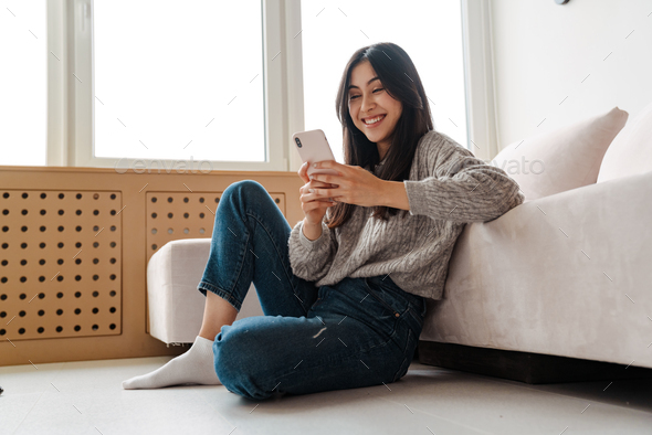 Attractive young woman using mobile phone - Stock Photo - Images