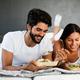 Couple in love having breakfast in bed. People, love, food concept - PhotoDune Item for Sale