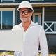 Proud male housebuilder presenting blank paper document - PhotoDune Item for Sale