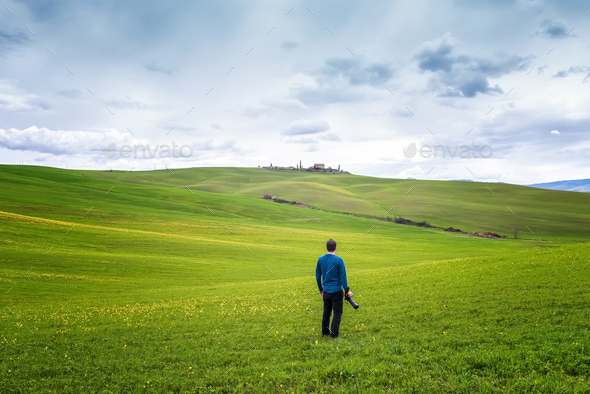 Photographer among picturesque Tuscany hills - Stock Photo - Images