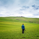 Photographer among picturesque Tuscany hills - PhotoDune Item for Sale