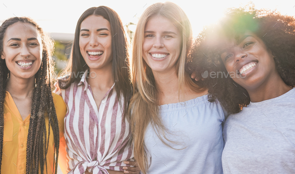 Beautiful multiracial girls looking and smiling on camera - Young women with different skin color - Stock Photo - Images