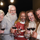 Senior multiracial people smiling on camera while celebrating christmas eve together - PhotoDune Item for Sale