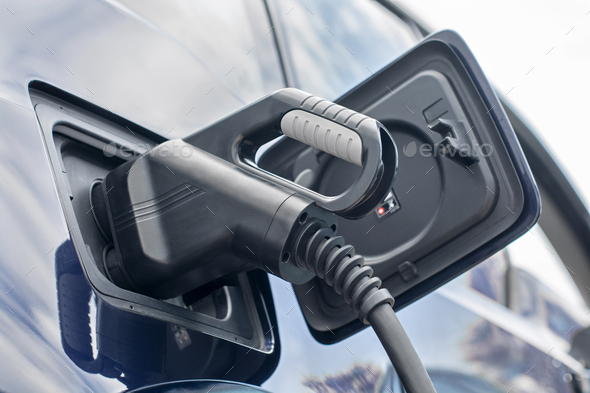 Electric Car Charging - Stock Photo - Images