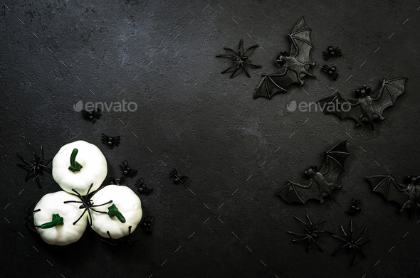 Happy Halloween black background with pumpkins, bats, spiders with copy space - Stock Photo - Images