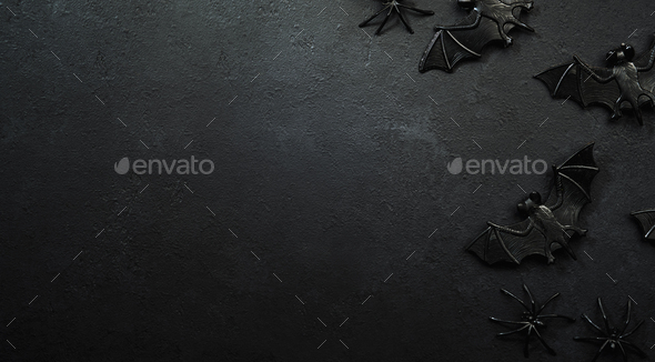 Happy Halloween black background with bats and spiders with copy space - Stock Photo - Images